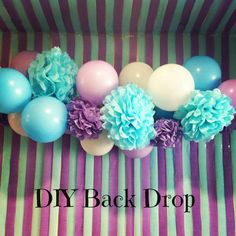 """Creative diy background. Love the Pom and balloon """"chandelier""""."""