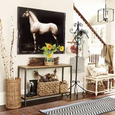I like the idea of a cool coat rack in that entry for visitors to hang coats and purse ;)