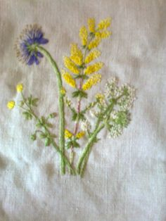 Summer flowers embroidered using a posy of the real thing as a guide. Blue Scabious, tiny pop poms of yellow Treffoil, Yellow Ladies Bedstraw and white hedge Bedstraw.