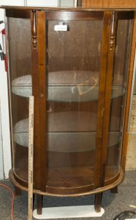VINTAGE CURIO CABINET WITH TWO GLASS SHELVES AND A BACK THAT IS