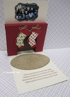 inside of card.  pop-up fireplace, decorative label punch family photo, stocking punch, oval die