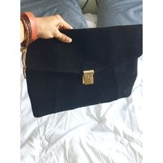 Black leather-like clutch Stylish leather like clutch with golden detailing and polka dotted inside cover.  This item has only been worn out once and is in 10/10 condition. Has a small inside zippered pocket. Unavaliable Bags Clutches & Wristlets