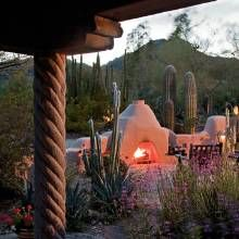 Garden renovation: Arizona landscape gets revitalized with an adobe-style stucco fireplace.