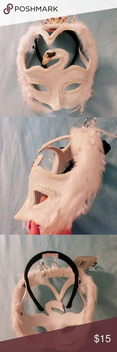 Halloween Masquerade Party White Swan Mask Fancy Masquerade Halloween white swan mask. New with tags. Has attached headband so it can sit on you perfectly. Has small defect. Missing one rhinestone on crown ( see last photo). It's not very noticeable and still looks great when worn. Has sequins and rhinestones on the crown. Feathers lining on outside of mask. Vibes of the Swan Lake. Wear this with a tulle skirt and you'll be all set to be the most chic at the party! Other