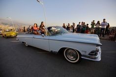 A participant drives a Buick Electra 225 during the Collection Cars Parade event in Amchit, Lebanon. (IBRAHIM CHALHOUB / AFP) http://pow.photos/2017/lebanon-pow-24-30-august/