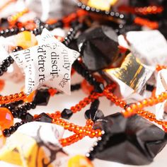 Garland for the decoration of your home. Garland with darkness (the black painted stars) and light (the orange pearls).    First I make the stars