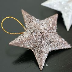 Glitter added to painted little paper mache star