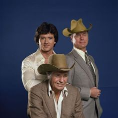 Patrick Duffy as Bobby Ewing, Larry Hagman as J.R. Ewing and Jim Davis as Jock Ewing.