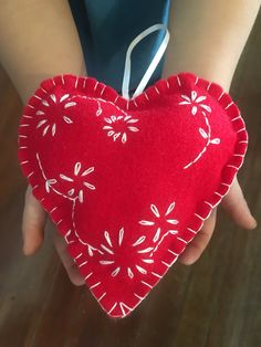 Two Scandinavian, hand embroidered, red and white heart ornaments