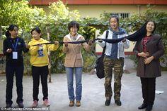 Ni Lunmei, de 57 años, no se ha cortado el cabello, desde los 16 años. Ahora mide 9 pies, 6 pulgadas (2,9m) de largo.