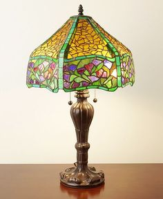 This Brown/Green Floral table lamp has been handcrafted using methods first developed by Louis Comfort Tiffany.