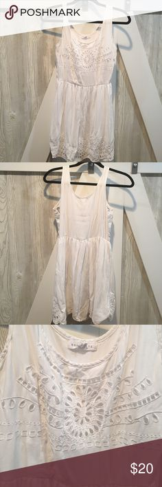 White dress - get ready for summer! Fun white dress with beautiful lace-like details. Dress is    100% rayon and lining is 100% polyester.  Zipper on the side. Socialite Dresses Mini
