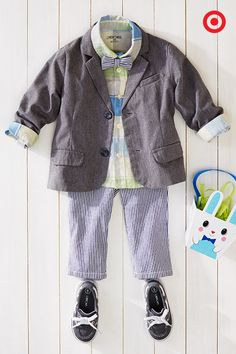 Get your toddler boy dressed for the Easter egg hunt with sweet seersucker pants, a matching bow tie and a colorful plaid shirt. Top that with a casual, gray blazer and boat shoes, and he'll be ready for the hunt!