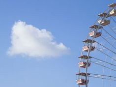 A cloud passes behind a large part of the wheel on the Jardin Albert 1er in Nice.