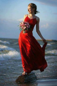 Lady in red in the middle of the beach