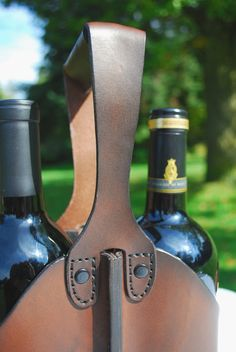 This unique hand-built all-leather double wine bottle caddy is the classiest way to carry your favorite bottles of vino to parties, events or to