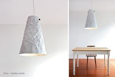 Ono Pendant Light - matte white. | With the Ono lights we have found another side of aluminum, making the most of it's malleability, beating the metal, working it back toward smoothness then beating it again until it begins to take on the texture of a crumpled sheet of paper. Ono comes in beaten, sandblasted raw aluminum, matte white or matte black lit with with a dimmable LED lamp and hung from a walnut spindle. | propellor.ca