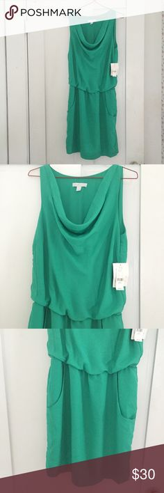 Cute drape neck teal dress NWT! Size xs Really cute dress I bought for an event and then didn't end up going. Never been worn, NWT! It's loose on top with a draped neckline and then more fitted on bottom with pockets! Really pretty teal green color. New York & Company Dresses Mini