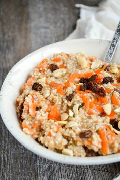 It's carrot cake in a healthy breakfast bowl! Carrot Cake Quinoa Oatmeal is gluten free, plant-based, refined sugar free, and absolutely delicious!