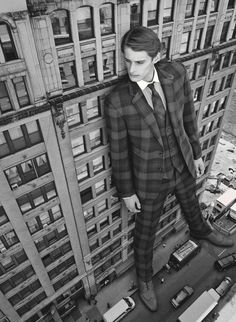 """Supersized Model Portraits. Jeremy Matos and Richard Detwiler star in """"Scale Model"""", a super-sized editorial exclusive for Details magazine. The newcomers are captured by photographer Christopher Griffiths' lens while donning an elegant wardrobe of tailored suit garments."""