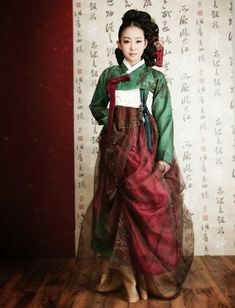 Korean hanbok - dark red and green, modernized. Check out source page for other really beautiful clothing from other countries!