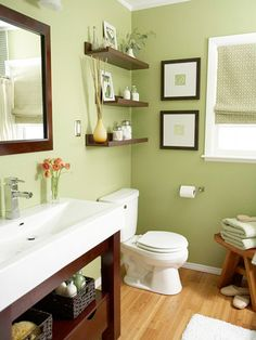 Love this wall color.  Add floating shelves. The narrow floating shelves popular in living rooms for displaying photos are ideal for adding storage to the bathroom where space is limited and toiletries are small.---minus the stool, this is great