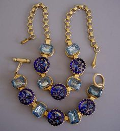 """DEEP blue glass with etched gold tone and inset rhinestones floral design and alternating pastel blue glass rhinestones all set in gold tone, 7-1/2"""" by 7/8"""" bracelet and 19"""" necklace ."""