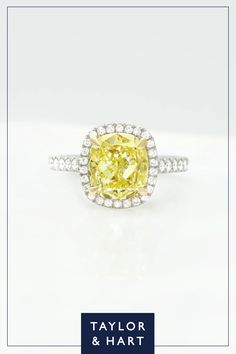 Hello sunshine! A fancy yellow diamond is set with 18ct yellow gold claws to further enhance the cheerful hue of the cushion-cut centre stone. Set in icy platinum, this classic pave diamond halo and band acts as the perfect contrast. Why not repin to your own inspiration board? #custom #bespoke #engagement #engagementring #classic #halo #fancydiamond #platinum