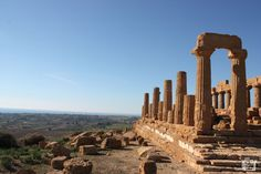 At the Valley of the temples, you will see one of the most outstanding examples of Greater Greece art and architecture. Valle dei Templi is a unesco world heritage site. Greece Art, Heritage Site, Historical Sites, Art And Architecture, Seattle Skyline, Cool Places To Visit, Europe, World, Temples