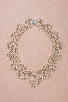 "Curvature Necklace from BHLDN: Fastened together by a mother-of-pearl button, lacy loops made of beads and pearls are a fresh twist on antique styling. From L'Orina. 18""L, 1.25""W. Freshwater pearls, glass beads, Swarovski crystals, cotton thread, polyester, mother-of-pearl. Handmade in France."