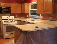counter remodel DIY on the cheap! This girl has tons of other remodeling tips as well, like floors and cabinets!