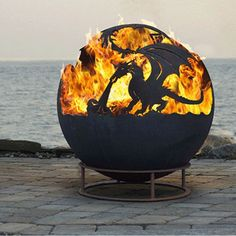 Gorgeous Dragon Fire Pit Up North Fire Pit Sphere Dyo Design Your Own Custom Firepit fire pits custom Wonderful Spherical Fire Pits Ideas - Go Travels Plan Fire Pit Sphere, Metal Fire Pit, Fire Pit Ball, Dragon Fire Pit, Outside Fire Pits, Fire Pit Materials, Fire Pit Ring, London Garden, Fire Pit Designs
