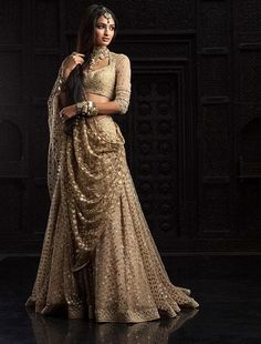 Absolutely love this Tarun Tahiliani piece from the Bridal and Couture Collection - Indian bride - Indian wedding - Indian designer - Indian couture - gold lehenga Indian Wedding Outfits, Bridal Outfits, Indian Outfits, Bridal Dresses, Dress Wedding, Wedding Ceremony, Couture Wedding Gowns, Flapper Dresses, Indian Clothes