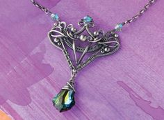 wire weaving pendant by Sarah Thompson - from Fixing Wire Jewelry Mistakes: How to Bounce Back from Tool Marks, Hard or Broken Wires, and Go with the Flow - Jewelry Making Daily