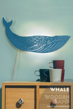 Majestic Blue whale lamp on your wall? This wooden wall lamp looks great both day and night. You can find more wooden and paper lamps in our SmagaWonderland shop! #whalelamp #nautocaldecor #lampdesign #nurserylamp #whaledecor #nauticalnursery #bluewhale