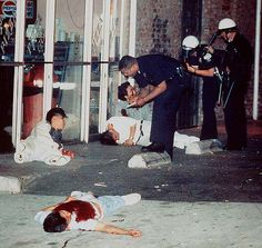 The 1992 Los Angeles riots - Edward Song Lee, 18, Forground, was shot to deth  3 others were injured in an exchange of gunfire with looters. police questioned the survivors of the attack who were shot while trying to protect a pizza parlor.