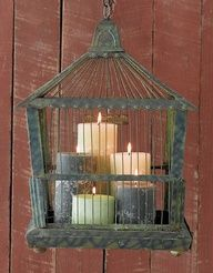 Good idea for bird cage by the living room fireplace.  Trying to figure out what would look good.  Like the candles of different heights and varying colors.