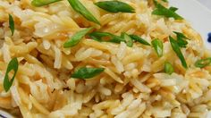 Rice and orzo pasta merge with the flavors of onion and garlic to create this versatile side dish.