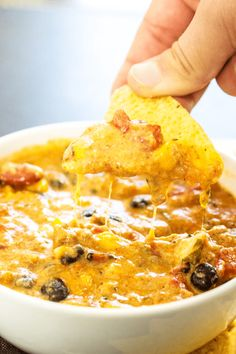 SLOW COOKER CHILI CHEESE DIP - cheesy and full of flavor, this easy recipe will be score a win on game day and be a hit over the holidays.