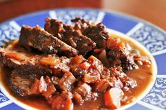 Italian Pot Roast ~ Italian pot roast recipe. Rump or chuck beef roast, first browned in olive oil, then slow cooked in a sofritto base of carrots, celery, and onion, with Italian plum tomatoes and red wine. ~ SimplyRecipes.com