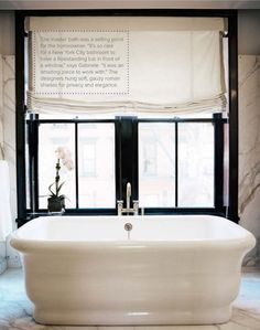 beautiful contrast with white bath and black window frames