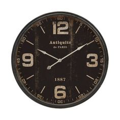 Featuring bold numerals and a distressed face, this stylish wall clock brims with antiqued appeal.  Product: Wall clock...