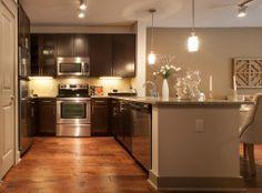 Model kitchen at #AMLI on Maple, a luxury apartment community in Dallas.