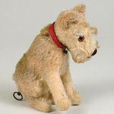 Vintage musical mohair dog.  Photo via web...