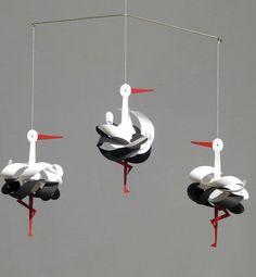 Mobile cigognes Livingly...D'une poèsie folle ! ... Du papier émerge une cigogne avec un enroulement en 3D...!
