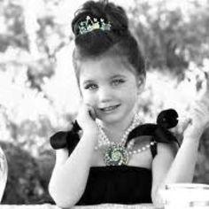 Little girl dressed as Audrey Hepburn in Breakfast at Tiffany's
