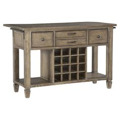 """Complete with an 11"""" drop leaf, this rustic kitchen island doubles as a table in small spaces. Three drawers, two open shelves, and a wine bottle rack add ve..."""