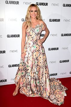 Amanda Holden stunned on the red carpet dressed in a graphic Rami Kadi floor sweeper. We love how hypnotic this print is.
