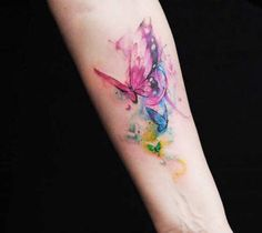 Very pretty watercolor tattoo style of Butterflies motive done by artist Versus Ink