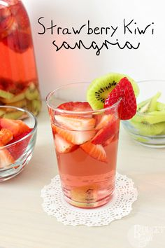 Strawberry Kiwi Sangria is simple to make, pretty to look at, and perfect for both brunch mimosas and summer evenings relaxing on the porch. || via diybudgetgirl.com #sanrgia #wine #strawberry #kiwi #spring #summer #fruit #moscato